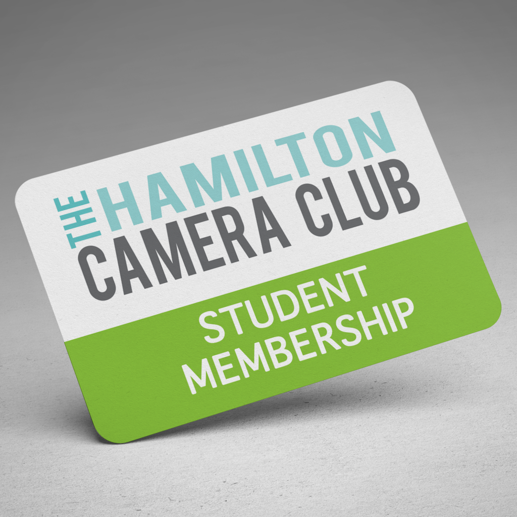 A white and green Hamilton Camera Club mebership card with the words Student Member